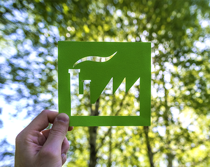 Illustration av industri med träd i bakgrunden.